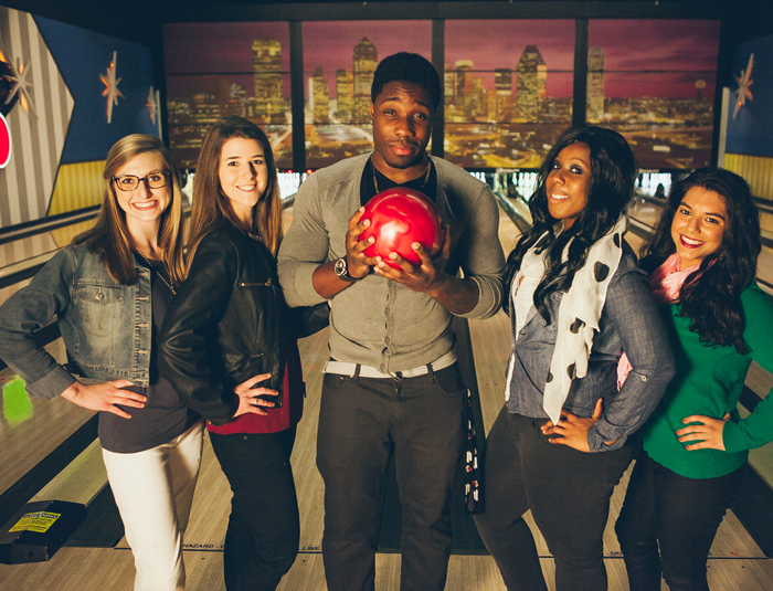 Group of people with a bowling ball